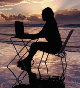 Woman-on-beach-with-laptop