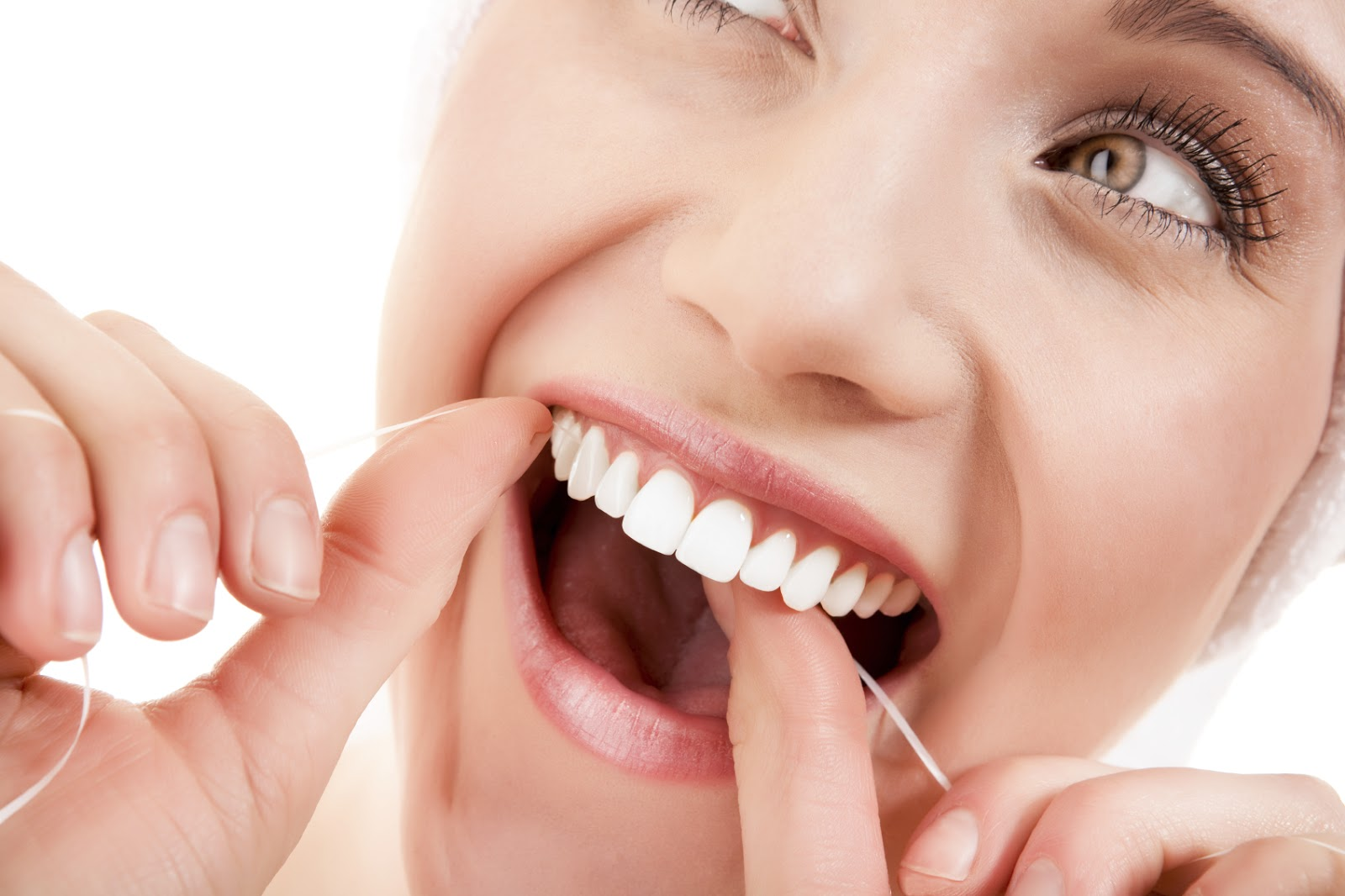 woman-flossing-white-teeth[1]